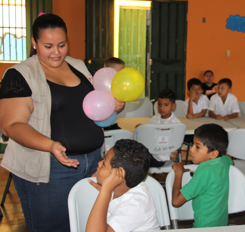 A CAZ technician carries out a school activity in Honduras.
