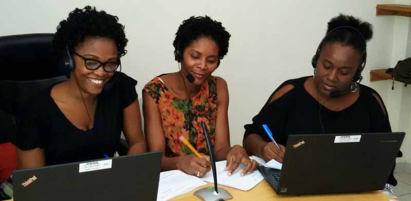 Partnership coordinators Djina Delatour, Julie Cadet-Elize, and Ricarda Germain of SHOPS Plus record a weekly radio show in the project's Port-au-Prince office using Skype.