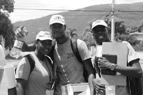 ZAP Vector Control Supervisor Odeki Turner (center) in the field with fellow ZAP supervisors. Photo: Jhevaughn Murphy